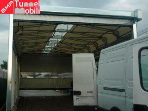 capannone in pvc con porta avvolgibile di Tunnel Mobili